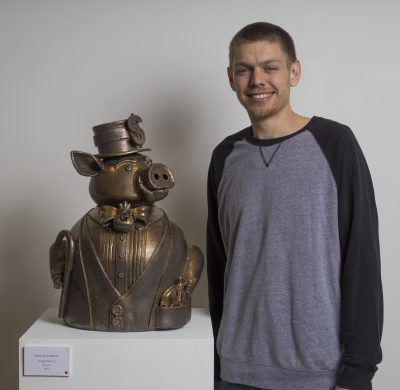 Taylor Gunderson pictured beside his piece, Sir Piggy Banks VI