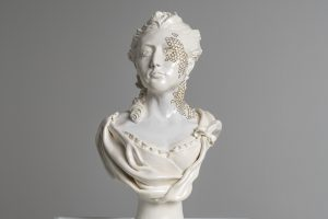 Sculpted ceramic bust of a woman, entitled Colonization