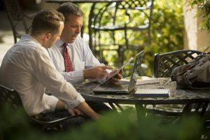 Professor Jason Palmer reviews and advises on student writing.