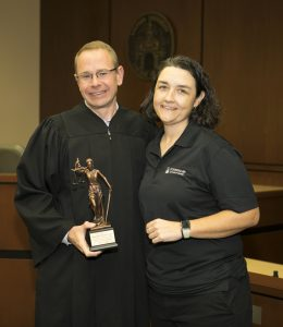 (L-R): Judge Michael Allen with Julia Metts accepting his award.