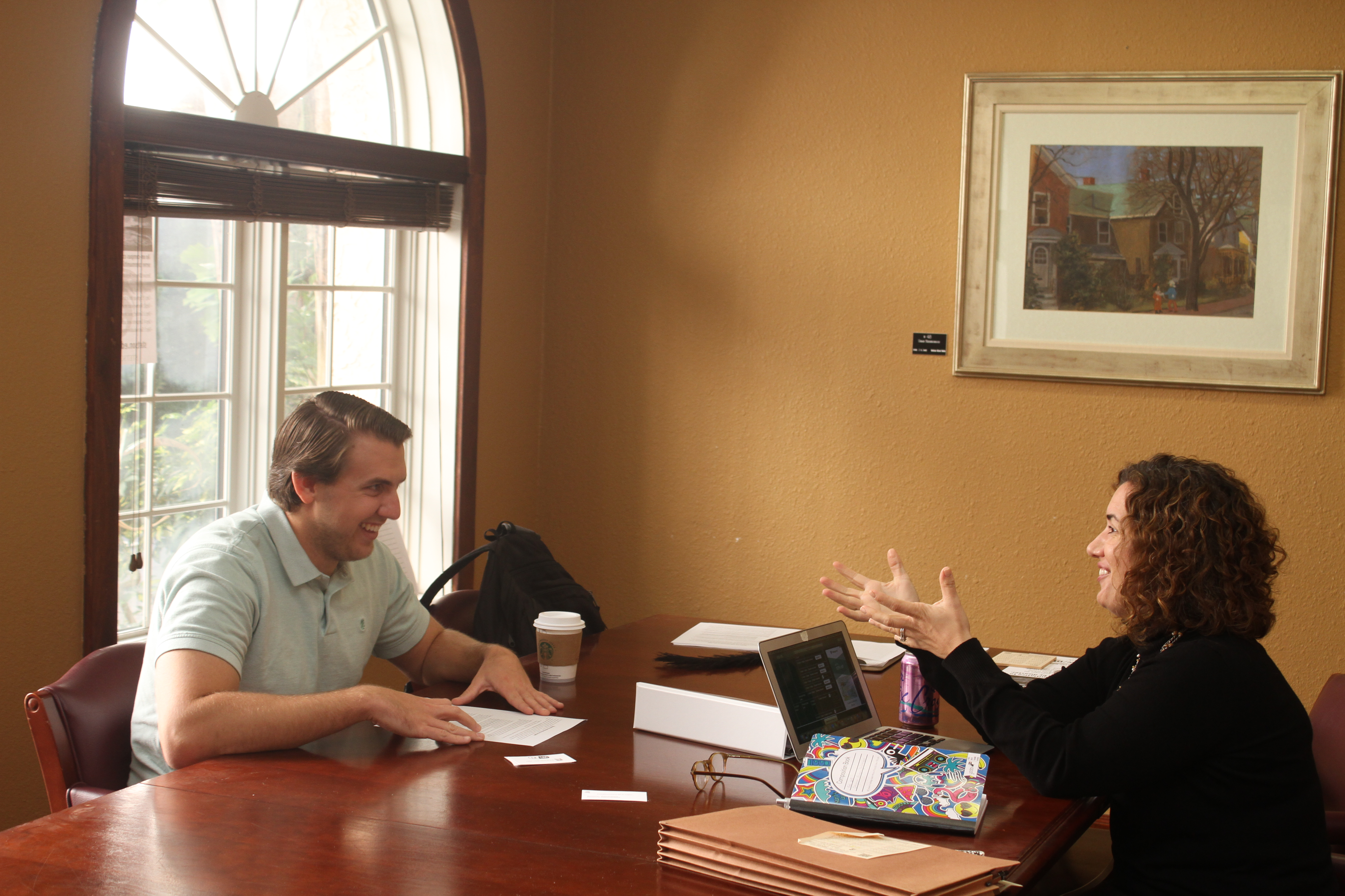 (L-R): Student works with Professor Cerniglia in the Disaster Research Project.