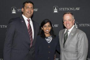 Prineet Sharma J.D. '98 and Shamila Sharma J.D. '96 with Dean Christopher Pietruszkiewicz.