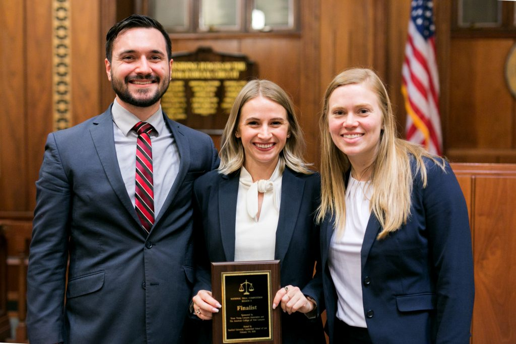 Matt Keen, Francesca Naumann (center), and Alicia Roddenberg were finalists at the regional competition. This was the first time in eight years that two Stetson teams made the finals.