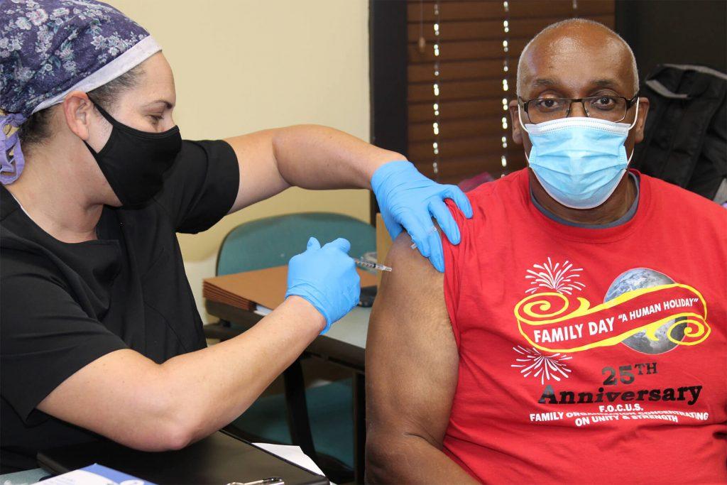 Professor Darryl Wilson gets a vaccine.