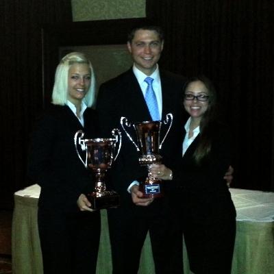 (L-R): Law students Erin Okuno, Chad Burgess and Morgan Vasigh won the Best Brief Award at the prestigious Andrews Kurth Moot Court National Championship.