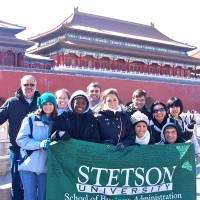 Gary Oliphant, left, with students in Beijing, China's Tiananmen Square in 2012. Rebecca Oliphant is pictured wearing sunglasses, third from right.