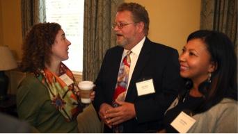 Anne Edmunds, left, granddaughter of J. Ollie Edmunds, speaks with two member of the Edmunds Scholars Program Board.