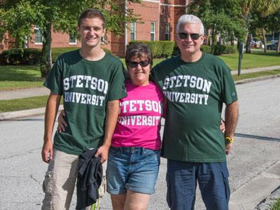 Three people wearing Stetson University t-shirts