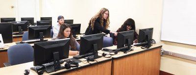 Professor Laura Gunn working with students