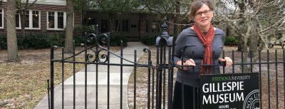 Karen Cole stands in front of the Gillespie Museum