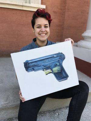 Senior Jasmine Ramos with artwork