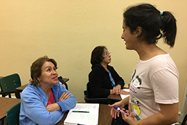 Stetson student Valeria Servigna tutors Julieta Almeida of Venezuela.