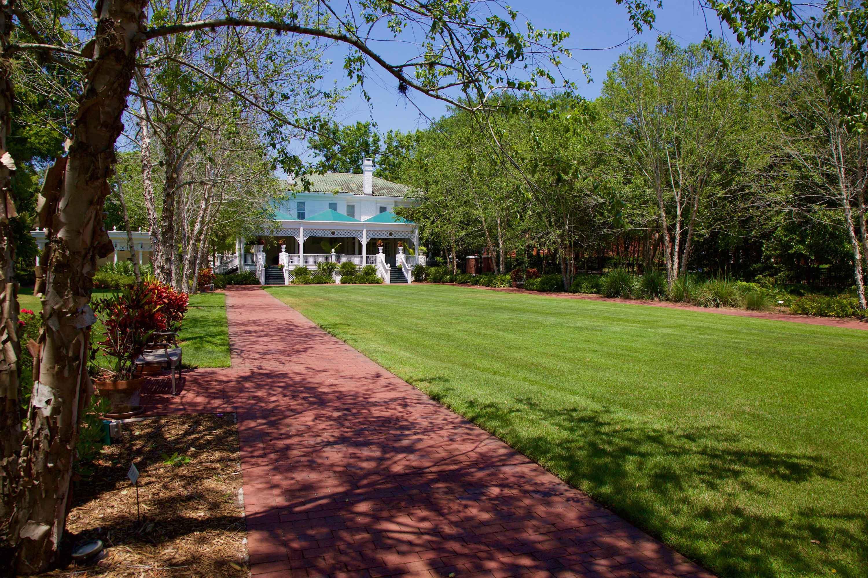 Scenic shot of Vera Lea Rinker Native Plant Garden beside President's Home.