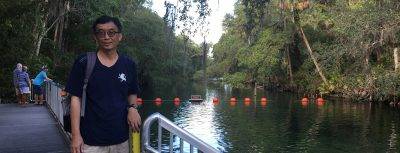Shih-hsiung Liang stands on platform next to Blue Spring