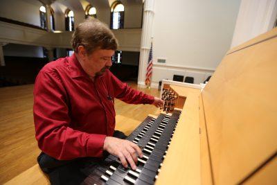 Boyd Jones plays the keyboards of the Beckerath Organ in Lee Chapel