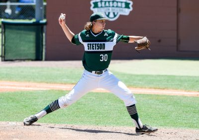 Logan Gilbert roars his arm back to pitch a fast one.
