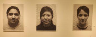 Three pixilated photos in art exhibit.