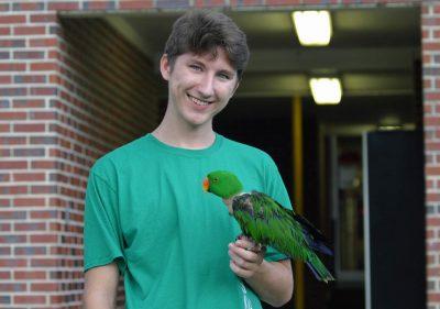 Aidan and his pet bird Sam