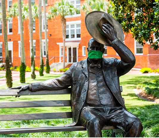 John B. Stetson statue wears a face covering
