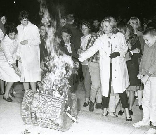 Students gather around the burning Yule Log during the Yule Log ceremony.