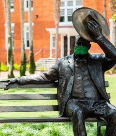 John B. Stetson statue wears a mask