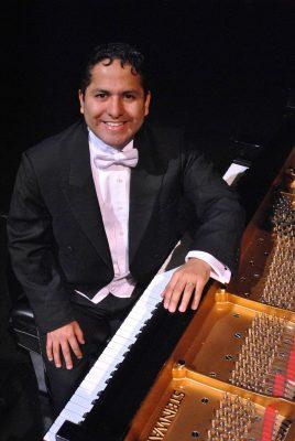 portrait in a tuxedo at a piano