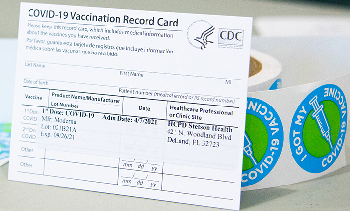 vaccination card sits propped up on table