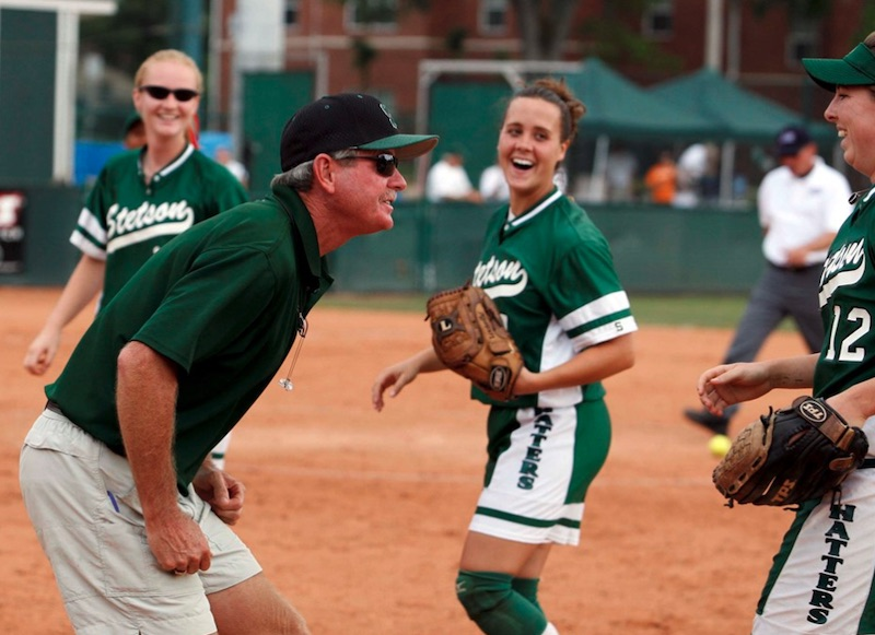 Frank Griffin shares a moment with players on the softball field.