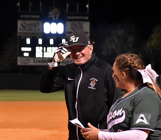 Frank Griffin is smiling on the softball field.