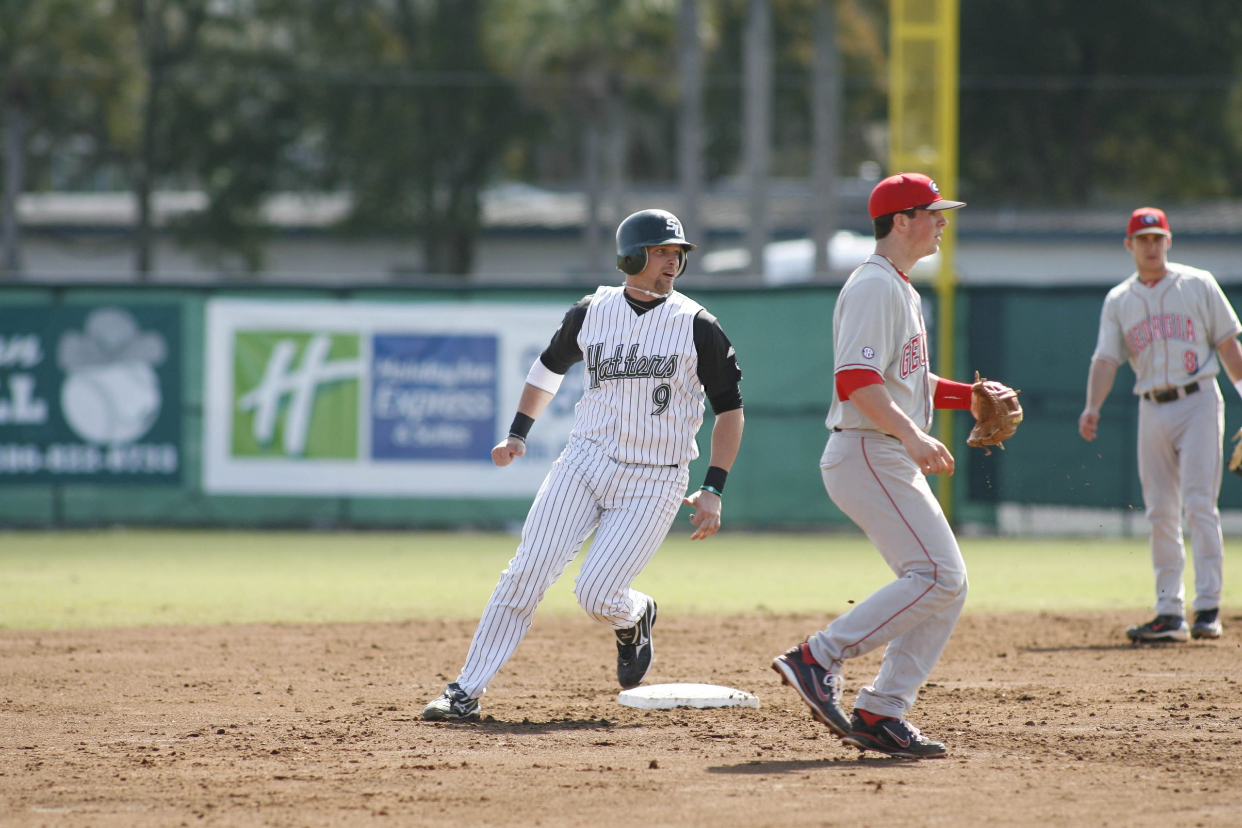 Nick Rickles tags a base during a Hatters baseball game.