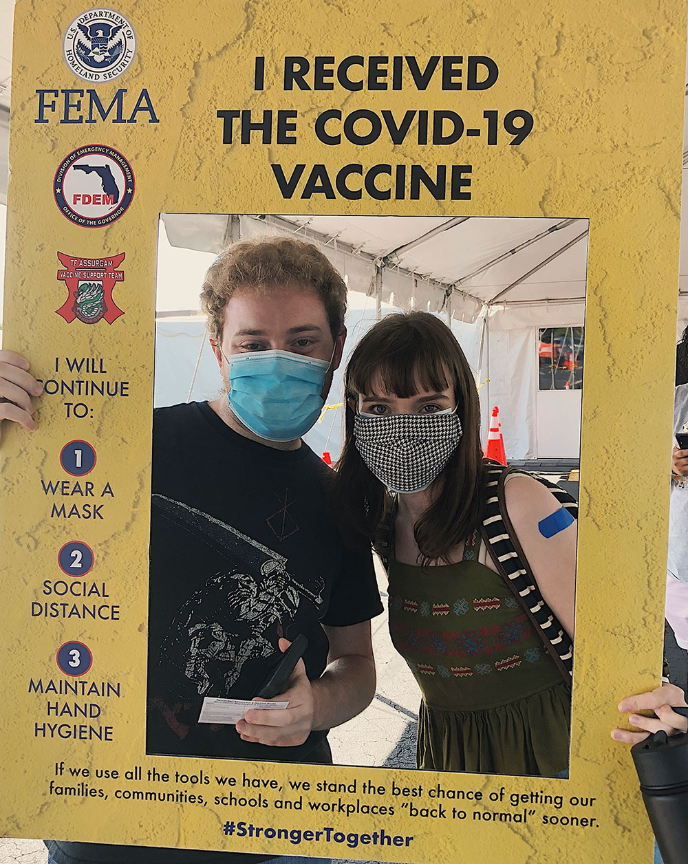 Two students pose at a vaccination site