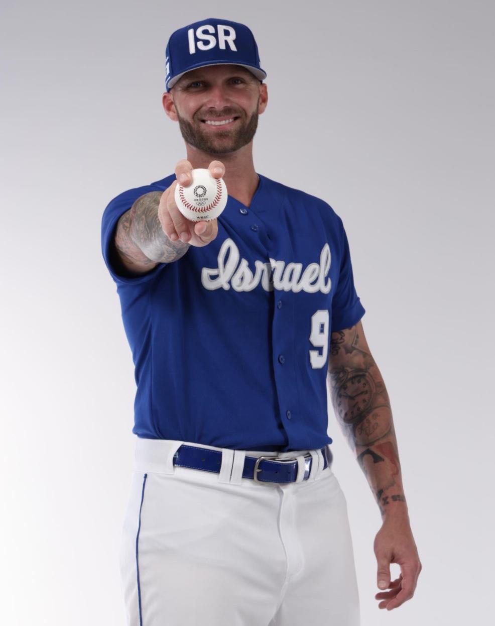 Nick Rickles in Israel baseball uniform holding a baseball.