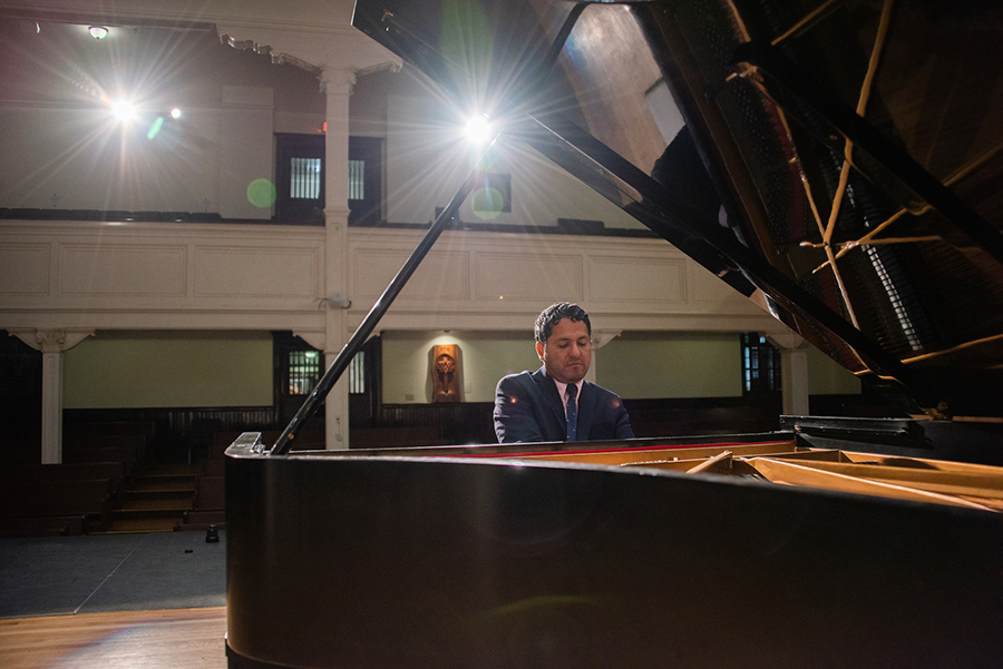 Washington Garcia plays in a grand piano in Lee Chapel.