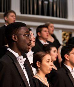Choir members sing in the Christmas concert