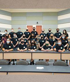 Large group photo inside Rinker Auditorium